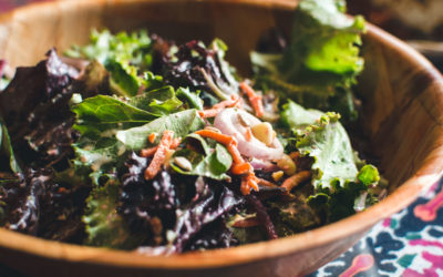 Green salad in a wooden bowl